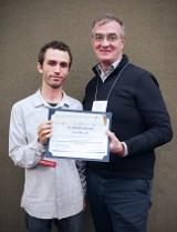 Javier García, SBI group (on the left) receives the prize from Stephen Friend, President of Sage Bionetworks